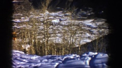 1961: snow and trees with ski tracks around them and a brief snippet of a lift Stock Footage