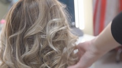 Stylish by professionals you can trust. hairdresser doing her clients hair with Stock Footage