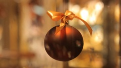 Sparkling Christmas ball against the backdrop of rising air bubbles in the water Stock Footage