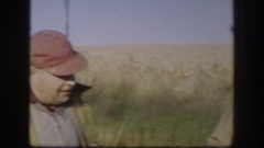 1958: one of two men smoking cigarette and other removing cap after hunting with Stock Footage