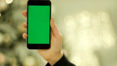 Close-up of female hands touching green screen on mobile phone. on the mobile Stock Footage