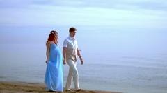 Love couple walking on beach. Pregnant couple walking beach. Couple beach Stock Footage