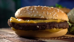 Tasty burgers on wooden table Stock Footage