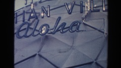 1961: hotel complex with terraces stands behind palm trees and resort area and Stock Footage