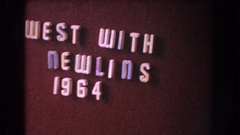 1960: an information board describing a 1964 class or team motto. possibly Stock Footage