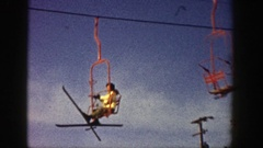 1961: skater with poles is sitting in the moving rope way ASPEN COLORADO Stock Footage