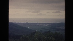 1961: old footage of a landscape with trees, mountain and a small city HAWAII Stock Footage