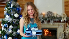 Christmas gift, girl gives a festive wrapped present, portrait of female Stock Footage