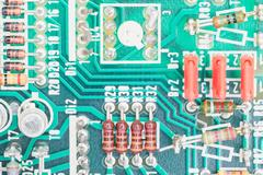 Condensers and Resistor assembly on the circuit board Stock Photos