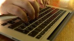 Typing On A Laptop Keyboard. Slow Motion Stock Footage