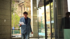 Young Businessman walking confident. Steadicam shot Stock Footage