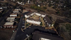 2016: aerial view of white townhomes in a cul-de-sac within a residential Stock Footage