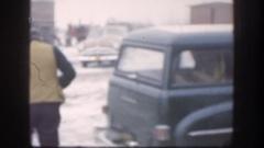 1958: a man gets off a motor vehicle carrying a long gun KANSAS Stock Footage