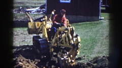 1958: man digging with bucket attachment on dozer NEBRASKA Stock Footage