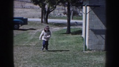 1958: baby runs at garden enjoys the childhood naughty things. NEBRASKA Stock Footage