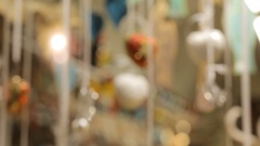 Blurred vintage Christmas decorations hanging in a glass on a background of gift Stock Footage