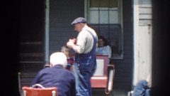 1958: a family relaxing outside talking together NEBRASKA Stock Footage