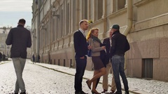 Friends stand on pavement on background of old city center street Stock Footage