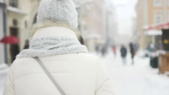 Attractive beautiful lady posing and flirting on camera over snowy city Stock Footage
