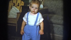 1959: a baby in blue overalls coming toward the camera smiling NEBRASKA Stock Footage
