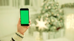 Close-up of female hands touching green screen on mobile phone. Chroma Key Stock Footage