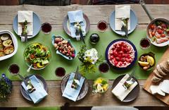 Variety of organic food on festive table served for holiday Stock Photos