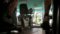 4K Male Feet Pedal On Bicycle Machine In Sport Gym. Man Exercising Gymnasium-Dan Stock Footage