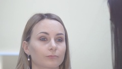 Make up artist putting on mascara on model's eyes. Eye make up Stock Footage