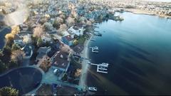 2016: flyover view of suburban neighborhood near lake COLORADO Stock Footage