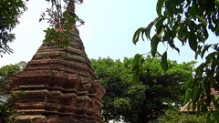 4K A massive brick centuries old Chedi at park of Chaingmai in Thailand-Dan Stock Footage