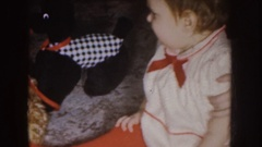 1955: a baby sitting on a carpet turns off a candle on a cake NEBRASKA Stock Footage