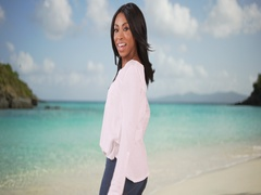 Beautiful African American woman on vacation at white sand beach  Stock Footage