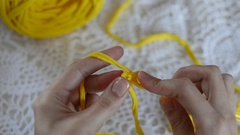 Close-up female's hands crocheting thick fabric yarn. Hobby handiwork concept Stock Footage