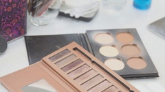 Brush and eye shadow makeup tools on the table Stock Footage