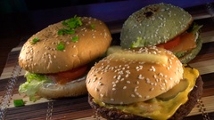 Slices of potate free falls on burgers Stock Footage