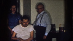 1957: a man comes to stand behind another man in a wheelchair NEBRASKA Stock Footage