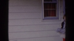 1957: girl in a dress wearing red tights, dancing and swinging her dress on the Stock Footage