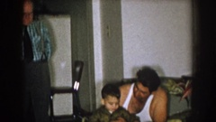 1957: a detailed look at a family of men gathered together covering several Stock Footage