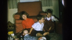 1957: one child, two toddlers and one baby on the living floor near the Stock Footage
