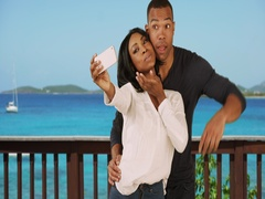 Black couple on vacation in Caribbean taking selfie together Stock Footage