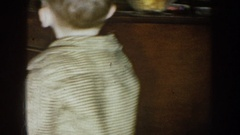 1957: a small blonde boy grabs a treat from a glass dish NEBRASKA Stock Footage