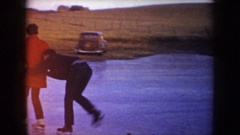 1953: man and woman ice skating on frozen pond NORTH DAKOTA Stock Footage