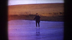 1953: 2 people ice skating on a pond NORTH DAKOTA Stock Footage