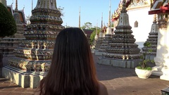 4K Beautiful Thailand woman orange dress walking in Phra Chedi Rai Wat Pho-Dan Stock Footage