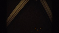 1952: long extended view of a beautiful church chandelier from ceiling to floor. Arkistovideo