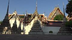 4K Beautiful Thailand woman orange dress walking in Phra Chedi Rai Wat Pho-Dan Stock Footage