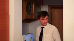 Young businessman preparing to go to work Stock Footage