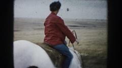 1953: woman riding a white horse in a plain. SOUTH DAKOTA Stock Footage