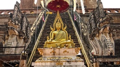 4K Golden Buddha statue Phra Chao Attarot outside temple at Wat Chedi Luang-Dan Stock Footage