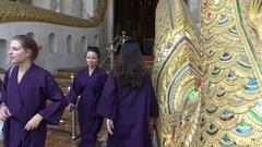 4K Women Tourist Visit Wat Ho Tham and wear the dress coat in purple cover-Dan Stock Footage